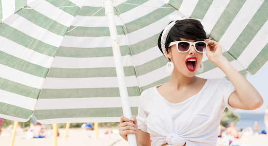 Woman with glasses on sunny beach
